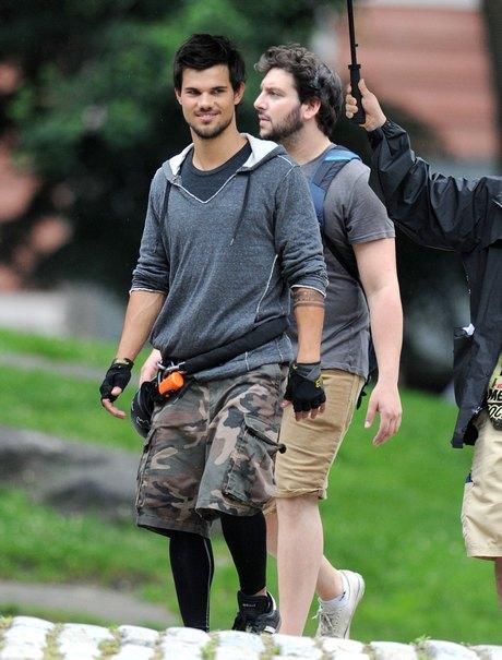 Taylor Lautner Rides A Bike On Set