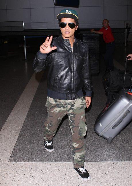 Bruno Mars Arriving On A Flight At LAX