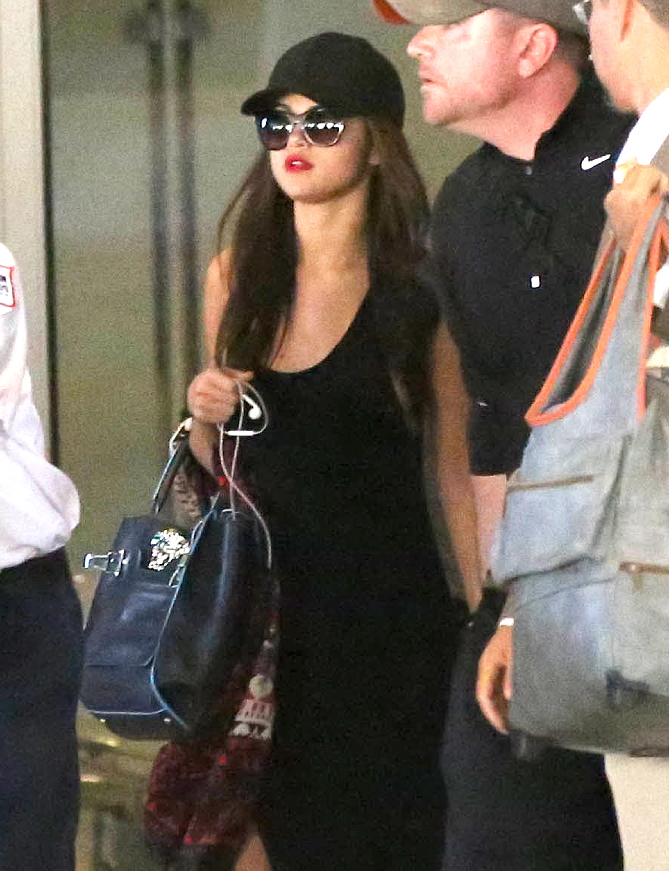Selena Gomez Arriving On A Flight At LAX